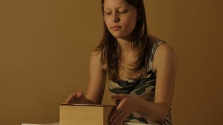 Teen girl with a book. 4K UHD