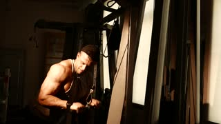 Young bodybuilder training in a gym.