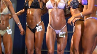 Athletes women at the bodybuilding competition. Fitness Female in sport competition.
