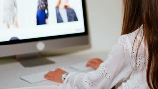 Attractive brunette girl using modern technologies for doing shopping online. Young teenager surfing on the internet and searching for online sales. Big sale online concept