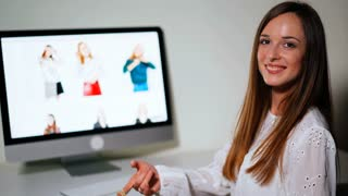 Attractive woman making shopping online at home. Pretty shopaholic female receiving her purchase made online on clothes website