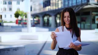 Business Woman which goes to work. Professional female manager with documents at modern business center. Close up