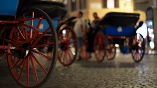 Carriages with horses in night time in Rome. Carriage rides tourist in Rome, Italy. 4K (UHD).