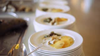 Chef's assistants helping with gourmet menu for party. Catering event. Exquisite serving dinner Catering food and service is of high quality. 4K (UHD).