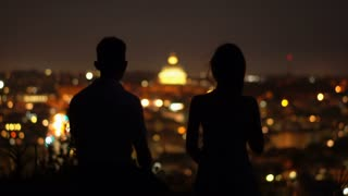 Embracing couple in the night. Italy, Rome. Silhouette. Man and woman at night time.