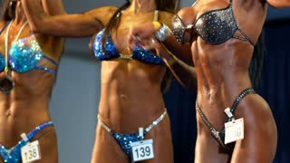 Fit Athletic Womans at a sporting event in bodybuilding or fitness women competitions
