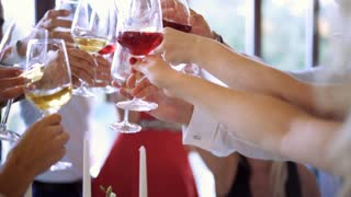 Group of people toasting at a celebration clinking their glasses together in congratulations. Birthday. Friends drinking Wine and toasting. Clink. 4K (UHD).
