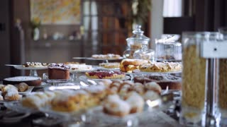 Hotel's menu including a wide range of breakfast food,such as eggs,breads,cereals,juices,fruits and bakery items. Hotel bar with a buffet. 4K (UHD).