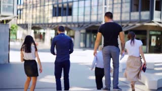 Male and Female Business People Walk and Discuss Business. . Business, startup and people concept.