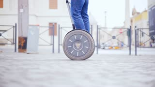 Male legs on a segway close-up of the wheels. Electric Vehicle Segway.
