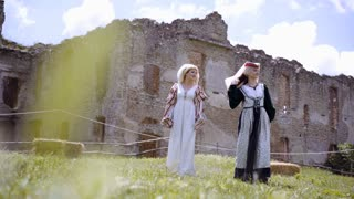 Medieval Kingdom. Two women are walking around the castle and waiting for their hero
