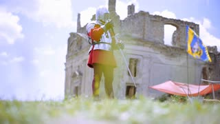 Medieval. Knight guarding the entrance to the castle. Historical reenactment.