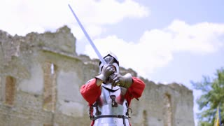 Old Knights in armor, medieval warrior preparing for battle, historical reenactment