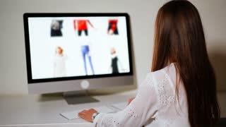 Online sales shopping girl in front of computer at home. Customer female making internet orders on the website with big sale