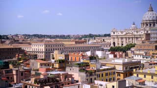 Panoramic view roman roofs and Vatican Saint Peter's basilica Dome. Historical Rome famous travel destination. Italy.