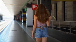 Passenger walking at a modern train station. Italy, Rome Termini