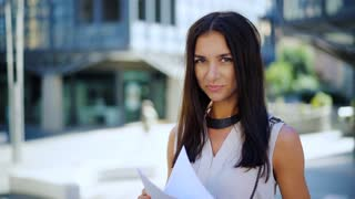 Portrait of a fashionable young professional woman. Attractive young caucasian businesswoman outside office building.