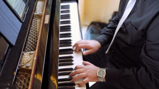 Professional pianist man playing piano. Keyboard instrument during play. Shot in 4K (UHD).