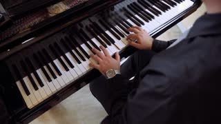 Professional pianist play classical piano music on the Grand Piano at the concert.