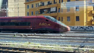 ROME, ITALY - MAY, 7, 2018: Fast Italian train modern. The train is departing from the main railway station TERMINI in Rome. Beautiful shooting in motion from the window of a parallel train. Italian