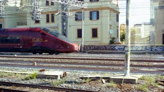 ROME, ITALY - MAY, 7, 2018: Fast Italian train modern. The train is departing from the main railway station TERMINI in Rome. Beautiful shooting in motion. Italian transports.