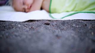Sleeping Baby Girl during family outdoor activities. Asleep child.