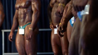 Sports strong men in bodybuilding competitions. Men athletes. Sport competition