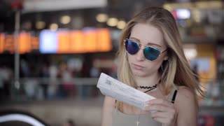 Tourist Woman in International Airport Checking Timetable
