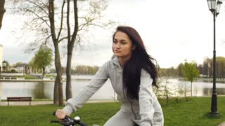 A girl riding a bicycle and smiling