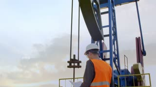 A Man Inspects Oil Rig