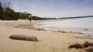 Athlete runs along the coast morning