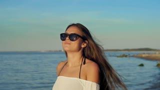 Beautiful girl walking on the beach