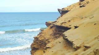 Big sandy cliff above the sea shore
