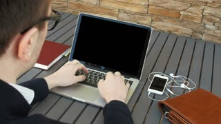 Businessman typing on a laptop