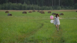 Child running with balloons