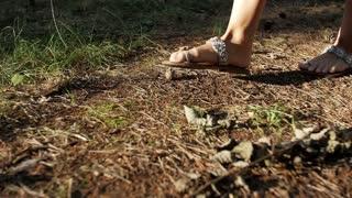 Feet girl walking on grass