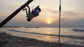 Fishing rod on the sunset background