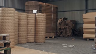 Forklift is shipping a stack of of empty pallets