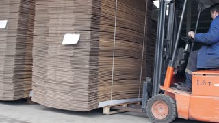 Forklift ships the a stack of cardboard