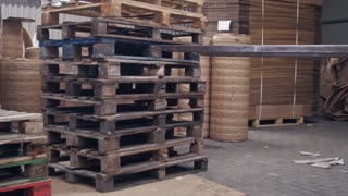 Forklift unloads pallets in the warehouse