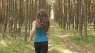 Girl running through the woods