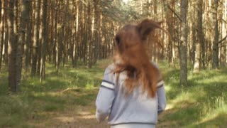 Girl runs along the forest