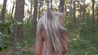 Girl runs through a thicket