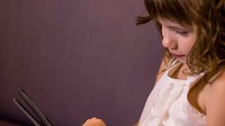 Kid Girl Uses Tablet