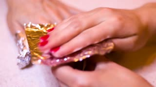 Manicurist makes manicure