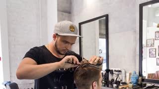 Mowing head men in barber
