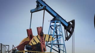 Oil derrick pumps oil