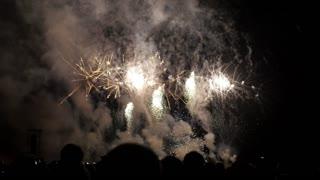 People look at fireworks