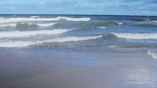 Sea waves along the shore