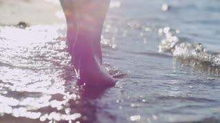 Splashing feet waves on the shore